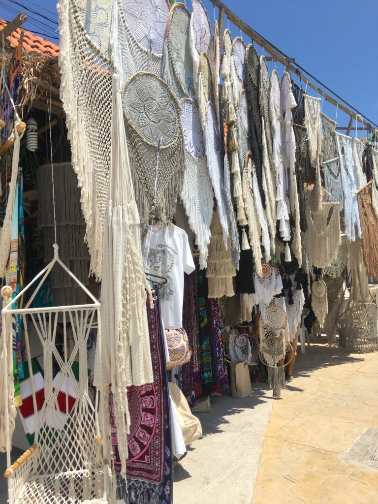 shopping on Tulum Ave, woven dream catchers and hammocks for sale