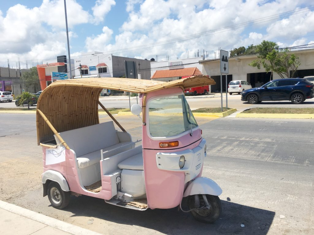 cute pink and white car in Tulum